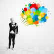Strange guy in morphsuit looking at colorful speech bubbles