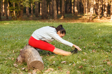 Young woman stretching and warming up