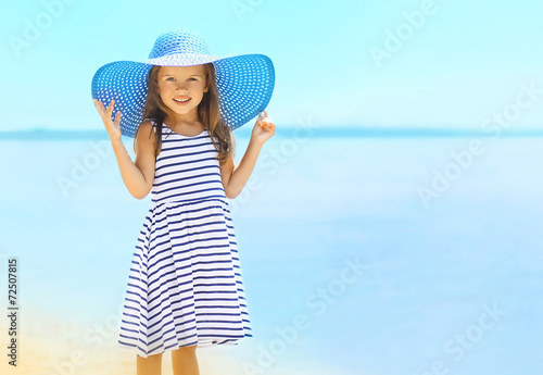 Leinwanddruck Bild Summer, vacation, travel and people concept - pretty little girl