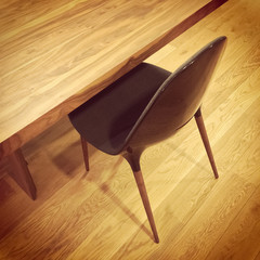 Black chair and wooden table