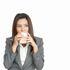 Business woman attractive young pretty drinking coffee relexatio