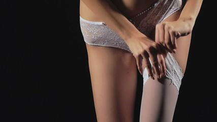 Young girl in erotic lingerie posing in the studio