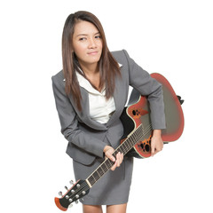 Asian business woman in suit playing guitar