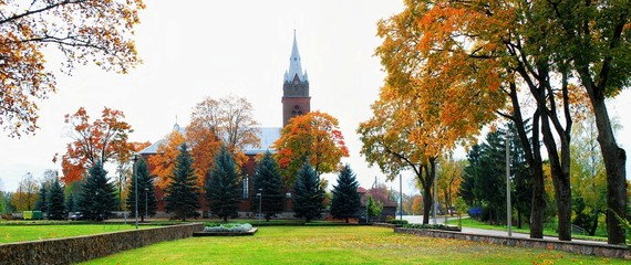 Church in little town at autumn time