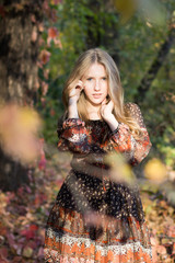 Young beautiful girl posing in park, autumn portrait