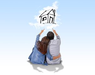 Young couple dreaming of new house in real state
