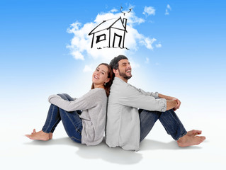 Young couple imaging new house in real state concept