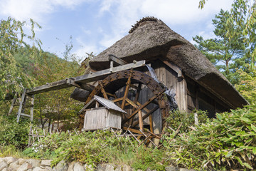 Water Wheel - Japanese thatched roofed house with a water mill