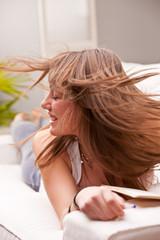 girl fluttering her brown hair