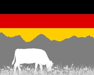 Kuh Alm und Deutschlandfahne