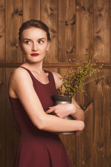 portrait of a beautiful girl in a burgundy dress