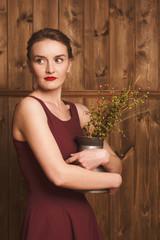 portrait of a beautiful girl in a burgundy dress