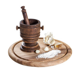 Wooden mortar with spices isolated on white background