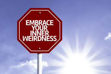 Embrace Your Inner Weirdness written on red road sign