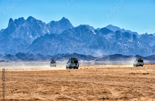 Egypt Landscape of Sahara desert with jeeps for safari.
