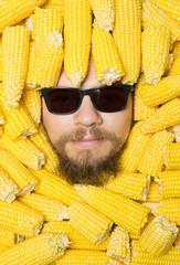 portrait close up of men  in  corn cobs