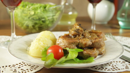 Fried pork chop with mushrooms and potatoes