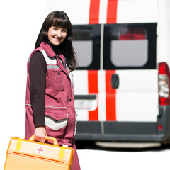 Happy emergency doctor with case at ambulance machine background