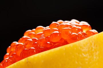 red caviar on the lemon