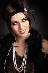 Beautiful retro woman in 20s style party outfit