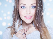 canvas print picture - Winter face close up of young woman covered with snowflakes