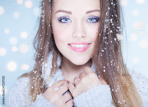 canvas print picture Winter face close up of young woman covered with snowflakes