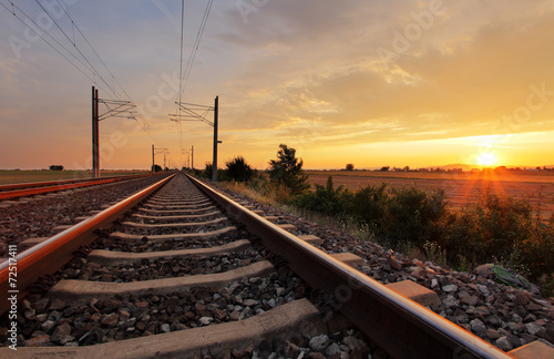 canvas print picture Railway at sunset