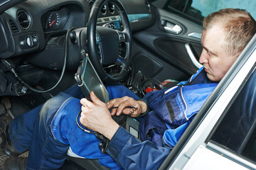 repairman servicing auto car
