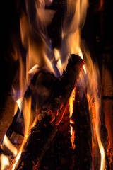 Closeup of burning and flaming firewood in fireplace