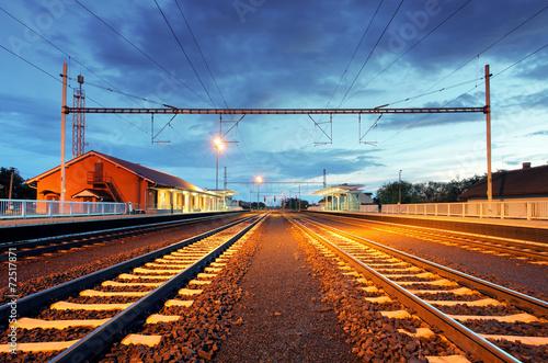 Train station in motion blur at night, railroad - 72517871