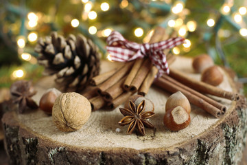 Chistmas composition with cinnamon, nuts and fir branches.