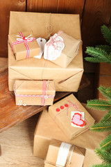 Christmas presents  near Christmas tree on wooden background