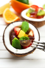 Fruit salad in coconut on table