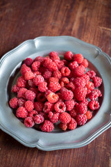 Fresh raspberry harvest on a plate