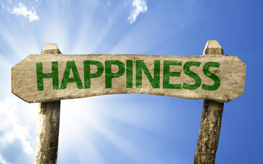 Happiness wooden sign on a beautiful day