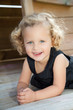 canvas print picture - kleines Kind liegt auf einem Spieltrum und ruht sich aus
