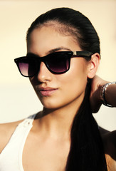 Young woman with sun glasses and pony tail