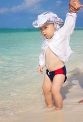 Little kid at the beach