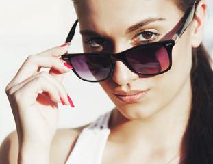 Pretty woman face with sun glasses