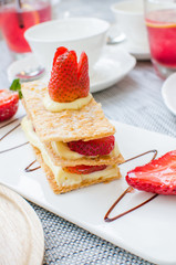 Mille feuille, puff pastry layered with strawberries and whipped