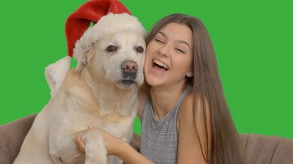 happy girl enjoys hugging her Labrador