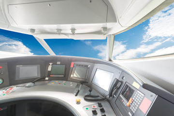 plane cockpit and cloudy sky