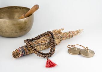 Singing Bowl, Prayer Beads, Meditation Bells and Smudge Stick.