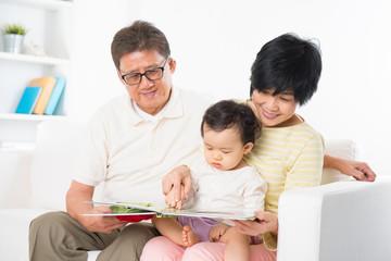 Asian family reading