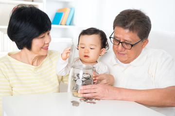 Asian family saving coins