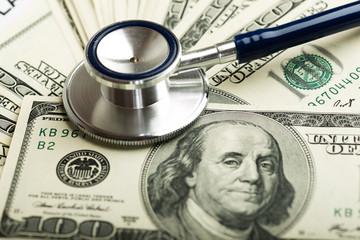 Stethoscope on money background - medical concept