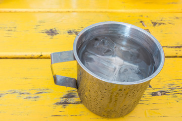 A metal cup of fresh water