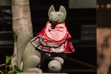 statue of decorated kitsune fox
