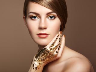 Magic woman portrait in gold