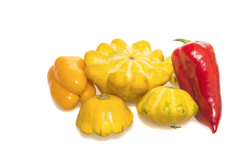 Multicolor peppers and yellow pattypan squashes   isolated